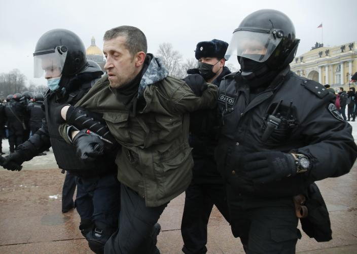 Police detain a man during a protest against the jailing of opposition leader Alexei Navalny in St.Petersburg, Russia, Saturday, Jan. 23, 2021. Russian police on Saturday arrested hundreds of protesters who took to the streets in temperatures as low as minus-50 C (minus-58 F) to demand the release of Alexei Navalny, the country's top opposition figure. A Navalny, President Vladimir Putin's most prominent foe, was arrested on Jan. 17 when he returned to Moscow from Germany, where he had spent five months recovering from a severe nerve-agent poisoning that he blames on the Kremlin. (AP Photo/Dmitri Lovetsky)