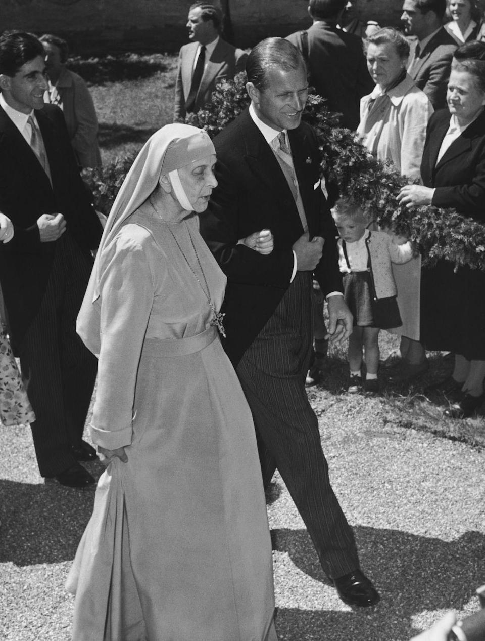 <p>Prince Philip attends the wedding of Prince Tomislav of Yugoslavia to Princess Margarita of Baden in Germany in 1957. He's accompanied by his mother, Princess Andrew of Greece (formerly Princess Alice of Battenberg).</p>