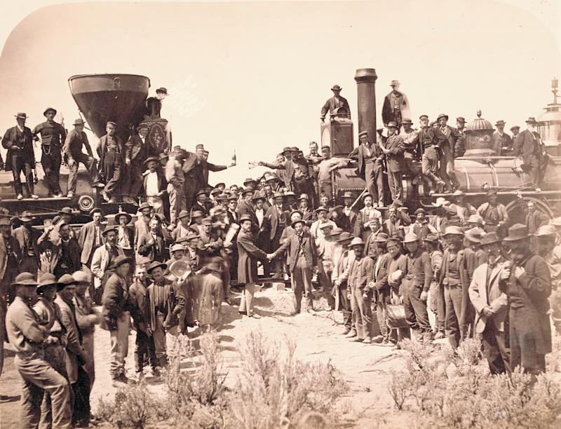 East and West shaking hands at laying of the last rail, Promontory Summit, Utah. Photograph was taken by Andrew Russell May 10, 1869. General Grenville Dodge, chief engineer for Union Pacific, is pictured shaking hands on the right with Central Pacific engineer Samuel Montague.