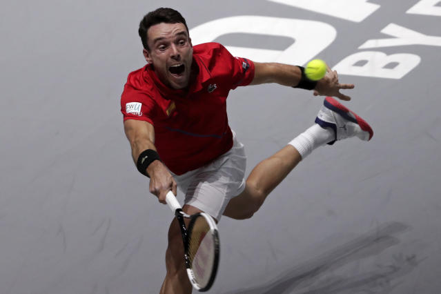 Spain's Roberto Bautista Agut returns the ball to Canada's Felix Auger-Aliassime during their tennis singles match of the Davis Cup final in Madrid, Spain, Sunday, Nov. 24, 2019. (AP Photo/Bernat Armangue)