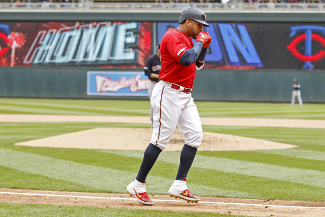 Minnesota Twins' Nelson Cruz celebrates his two-run home run against the Cleveland Indians in the fifth inning of a baseball game Sunday, March 31, 2019, in Minneapolis. (AP Photo/Bruce Kluckhohn)