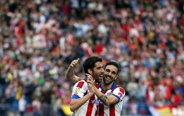 Atletico Madrid's Raul Garcia (L) celebrates scoring against Elche with teammate Jesus Gamez during their Spanish first division soccer match at Vicente Calderon stadium in Madrid, April 25, 2015. REUTERS/Susana Vera