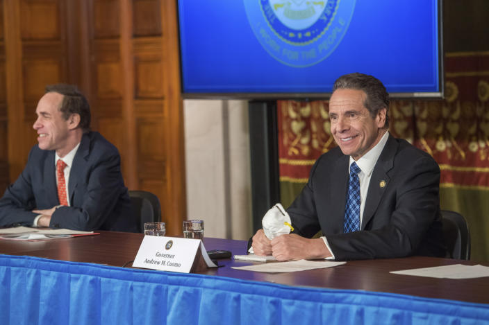 In this April 24, 2020 photo provided by the Office of Governor Andrew M. Cuomo, Gov. Cuomo addresses the media while holding an n95 mask during his daily press briefing on COVID-19, Coronavirus, at the State Capitol in Albany, N.Y. The mask was sent to the governor by a retired farmer from Kansas whose wife only has one lung. He asked that the governor give it to a doctor or a nurse. At left is Dr. Howard Zucker, Commissioner of New York State Department of Health. (Darren McGee/Office of Governor Andrew M. Cuomo via AP)