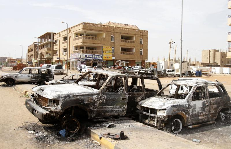 Destroyed cars are left after rioters torched a fuel station in Khartoum, Sudan, Thursday, Sept. 26, 2013. Sudanese authorities have deployed troops around vital installations and gas stations in Khartoum following days of deadly rioting over gas price hikes. (AP Photo/Abd Raouf)