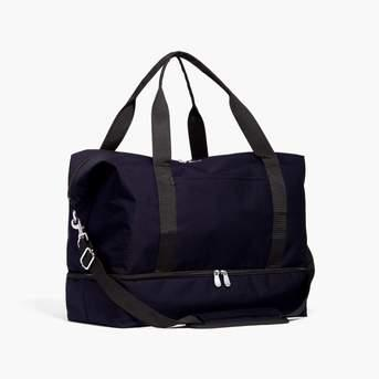 """<h3><a href=""""https://www.loandsons.com/collections/sale/products/catalina-deluxe-600d-recycled-poly-deep-navy"""" rel=""""nofollow noopener"""" target=""""_blank"""" data-ylk=""""slk:The Catalina Deluxe"""" class=""""link rapid-noclick-resp"""">The Catalina Deluxe</a></h3><br>This <a href=""""https://www.refinery29.com/en-us/best-travel-bags"""" rel=""""nofollow noopener"""" target=""""_blank"""" data-ylk=""""slk:top-bought bag"""" class=""""link rapid-noclick-resp"""">top-bought bag</a> has been featured in much of our <a href=""""https://www.refinery29.com/en-us/best-weekender-bags-for-women"""" rel=""""nofollow noopener"""" target=""""_blank"""" data-ylk=""""slk:travel coverage"""" class=""""link rapid-noclick-resp"""">travel coverage</a> for its chic-utility — but, it's recent most wanted resurgence we owe to a <a href=""""https://www.refinery29.com/en-us/2019/11/8889814/lo-and-sons-bags-black-friday-sale-2019"""" rel=""""nofollow noopener"""" target=""""_blank"""" data-ylk=""""slk:mega sale that the Lo & Sons dropped earlier this week"""" class=""""link rapid-noclick-resp"""">mega sale that the Lo & Sons dropped earlier this week</a> with up to 60% off a selection of styles and colors. <br><br><strong>Lo & Sons</strong> The Catalina Deluxe, $, available at <a href=""""https://www.loandsons.com/collections/sale/products/catalina-deluxe-600d-recycled-poly-deep-navy"""" rel=""""nofollow noopener"""" target=""""_blank"""" data-ylk=""""slk:Lo & Sons"""" class=""""link rapid-noclick-resp"""">Lo & Sons</a>"""