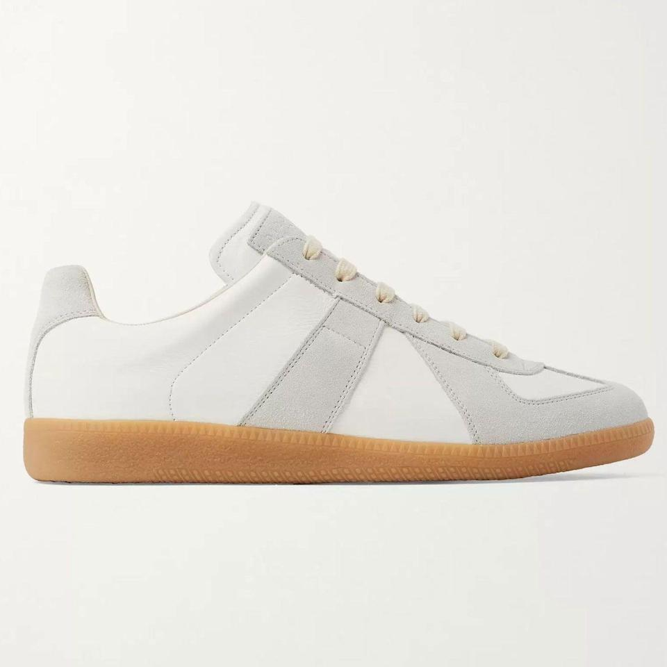 """<p><strong>Replica Sneakers</strong></p><p>mrporter.com</p><p><strong>$470.00</strong></p><p><a href=""""https://go.redirectingat.com?id=74968X1596630&url=https%3A%2F%2Fwww.mrporter.com%2Fen-us%2Fmens%2Fproduct%2Fmaison-margiela%2Fshoes%2Flow-top-sneakers%2Freplica-leather-and-suede-sneakers%2F3024088872988665&sref=https%3A%2F%2Fwww.esquire.com%2Fstyle%2Fmens-accessories%2Fadvice%2Fg2538%2Fluxury-sneaker-brands-worth-spending-money%2F"""" rel=""""nofollow noopener"""" target=""""_blank"""" data-ylk=""""slk:Shop Now"""" class=""""link rapid-noclick-resp"""">Shop Now</a></p><p>Maison Margiela's designer footwear legacy has remained relatively untouched. Its most prominent product is an upscale reinterpretation of a standard-issue German army trainer sneaker, done up in white leather with suede accents and a gum sole. It's also been reinterpreted in numerous colorways and treatments, ranging from meticulous paint splatters to iridescent metallic leather and intricate basket-weave materials. </p>"""