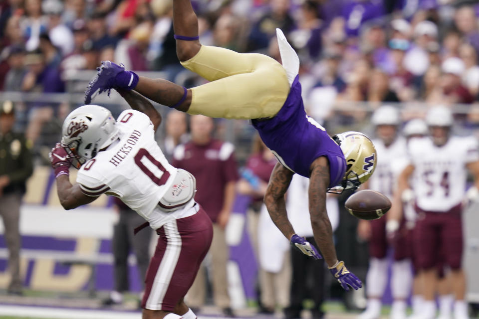 Montana's Omar Hicks Onu (0) upends and breaks up a pass intended for Washington's Giles Jackson in the first half of an NCAA college football game Saturday, Sept. 4, 2021, in Seattle. (AP Photo/Elaine Thompson)