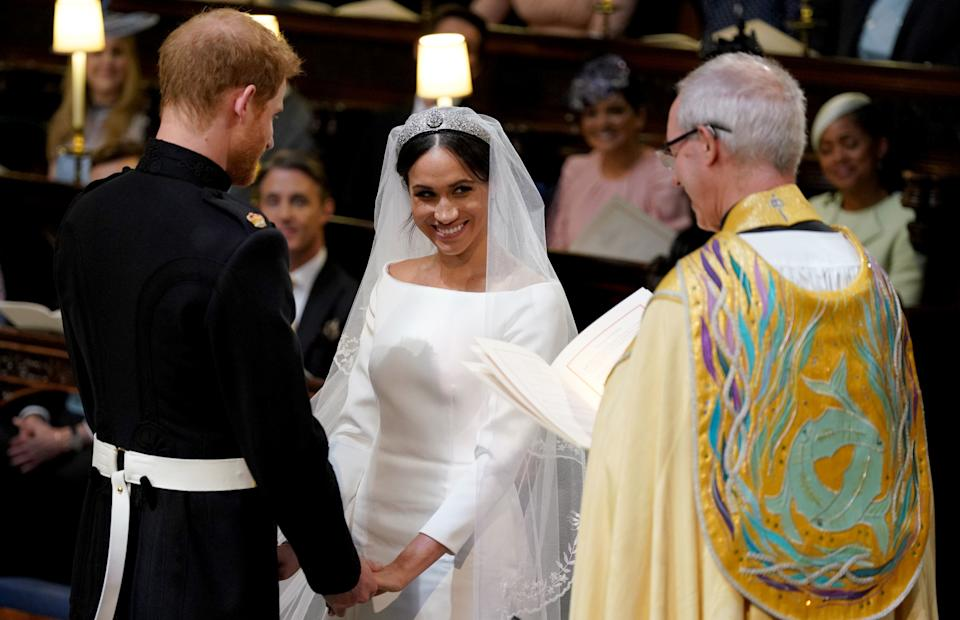 Prince Harry and Meghan Markle during their wedding service, conducted by the Archbishop of Canterbury. Meghan says on Oprah they wed beforehand