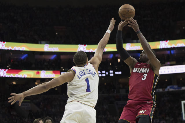 Miami Heat's Dwyane Wade, right, shoots with Philadelphia 76ers' Justin Anderson, left, defending during the first half in Game 5 of a first-round NBA basketball playoff series, Tuesday, April 24, 2018, in Philadelphia. (AP Photo/Chris Szagola)