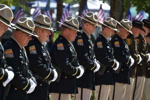 PHOTO: Members of the Arizona Department of Public Safety line up before the casket of Senator John McCain is carried by members of the Arizona National Guard to the Arizona State Capitol Rotunda where he will lie in state, Aug. 29, 2018 in Phoenix. (Robyn Beck/AFP/Getty Images)