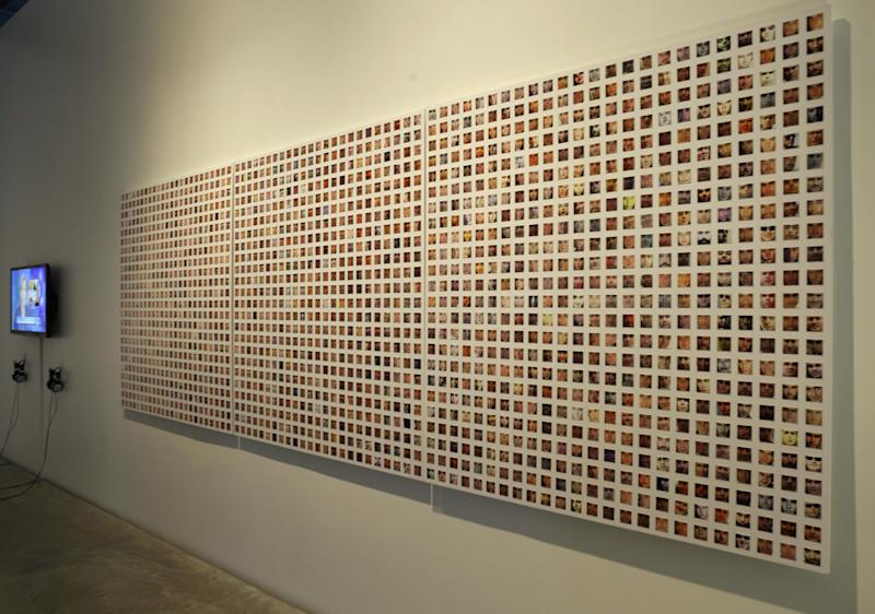 "This Tuesday, March 5, 2013, photo, shows hundreds of images of people's faces taken from Facebook as part of Paolo CirioI's and Alessandro Ludovicoa's mixed media installation in ""The Public Private"" exhibit at the Anna-Maria and Stephen Kellen Gallery in the Sheila C. Johnson Design Center at Parsons The New School for Design in New York. The exhibit seeks to explore the boundaries and gray areas of online privacy, surveillance and data collection in the age of Facebook and Google. (AP Photo/Kathy Willens)"