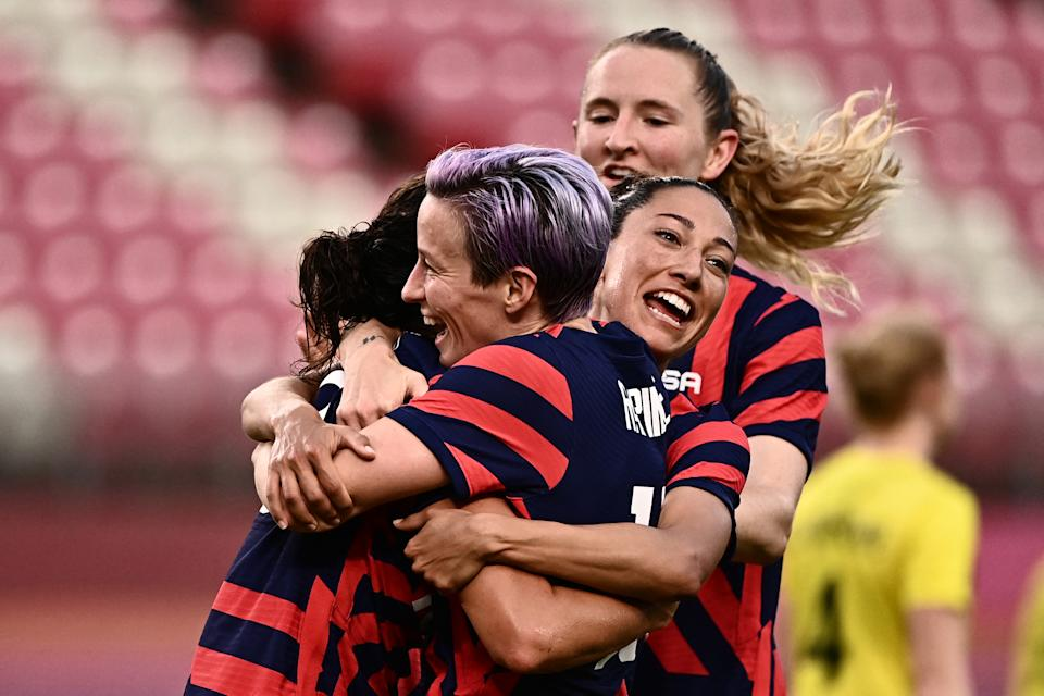 USA's forward Carli Lloyd (L) is congratulated by teammates after scoring during the Tokyo 2020 Olympic Games women's bronze medal football match between Australia and the United States at Ibaraki Kashima Stadium in Kashima city, Ibaraki prefecture on August 5, 2021. (Photo by Jeff PACHOUD / AFP) (Photo by JEFF PACHOUD/AFP via Getty Images)