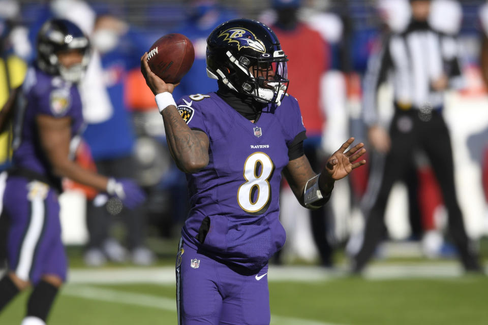 Baltimore Ravens quarterback Lamar Jackson looks to throw a pass against the New York Giants during the first half of an NFL football game, Sunday, Dec. 27, 2020, in Baltimore. (AP Photo/Nick Wass)