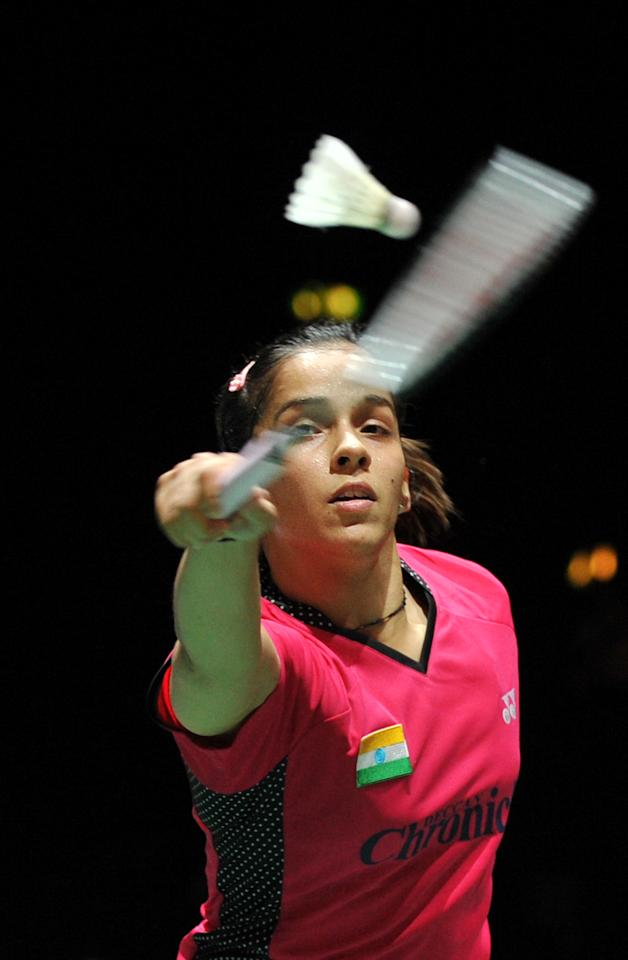India's Saina Nehwal returns a shot to China's Wang Xin (not seen) during the womens singles quater finals at the World Badminton Championships at Wembley Arena in London, on August 12, 2011. AFP PHOTO/BEN STANSALL (Photo credit should read BEN STANSALL/AFP/Getty Images)