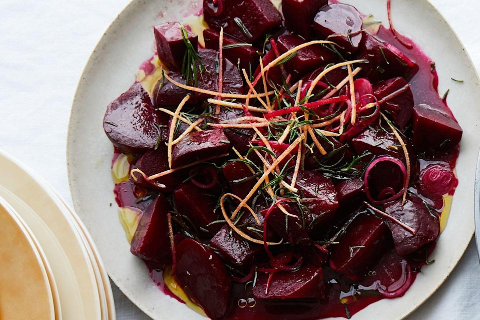 "Grapefruit zest and juice balance the sweetness of the beets in this simple salad. Crispy fried rosemary is a fantastic finishing touch. <a href=""https://www.epicurious.com/recipes/food/views/roasted-beets-with-grapefruit-and-rosemary?mbid=synd_yahoo_rss"" rel=""nofollow noopener"" target=""_blank"" data-ylk=""slk:See recipe."" class=""link rapid-noclick-resp"">See recipe.</a>"