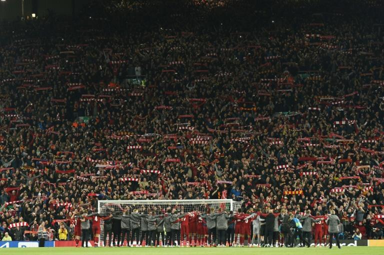 12th man: Liverpool players celebrate a 4-0 Champions League semi-final, second leg win over Barcelona in front of the Kop stand at Anfield
