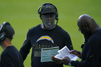 Los Angeles Chargers head coach Anthony Lynn, center, talks to his staff on the sidelines during the first half of an NFL football game against the Miami Dolphins, Sunday, Nov. 15, 2020, in Miami Gardens, Fla. (AP Photo/Lynne Sladky)