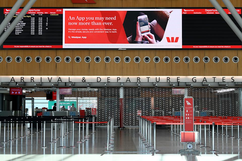 An empty arrivals and departures security point is seen at the Qantas terminal at Sydney Airport. Source: AAP