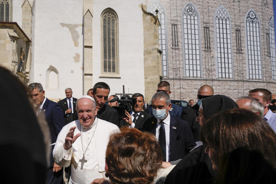 Pope Francis greets faithful as he leaves the Cathedral of Saint Martin, in Bratislava, Slovakia, Monday, Sept. 13, 2021. Francis is on a four-day visit to Central Europe, in Hungary and Slovakia, in his first big international outing since undergoing intestinal surgery in July. (AP Photo/Petr David Josek)