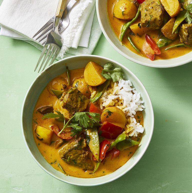 """<p>Curry may feel like more of a dinner item than a lunch one, """"but there's nothing stopping you from enjoying ... your favorite curry with rice in the middle of the day,"""" Moore says. Yellow chiles and turmeric give this meal a comforting, bold flavor, and you can always cut the potatoes out if you're looking for a low-carb dish. </p><p><em><a href=""""https://www.womansday.com/food-recipes/a31980192/thai-beef-and-vegetable-curry-recipe/"""" rel=""""nofollow noopener"""" target=""""_blank"""" data-ylk=""""slk:Get the Thai Beef and Vegetable Curry recipe."""" class=""""link rapid-noclick-resp"""">Get the Thai Beef and Vegetable Curry recipe.</a></em></p>"""