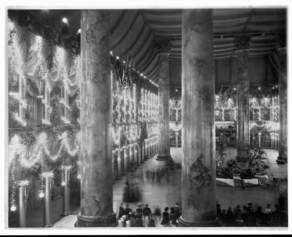 <p>This photo reveals the ballroom where President McKinley's second inaugural ball took place and reveals extensive decorations of garlands and lights for the celebration in 1901. </p>