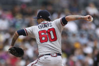 Atlanta Braves starting pitcher Jesse Chavez winds up against the San Diego Padres in the first inning of a baseball game Sunday, Sept. 26, 2021, in San Diego. (AP Photo/Derrick Tuskan)