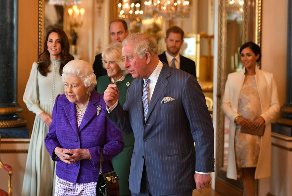 The Queen hosted the reception for Prince Charles at Buckingham Palace and was joined by Camilla, Kate, William, Harry and Meghan [Photo: PA]