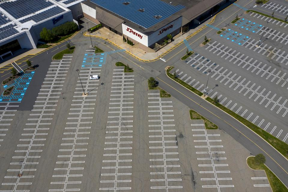 A JC Penney department store seen above empty parking lots at Woodbridge Center Mall that remains closed due to the ongoing outbreak of the coronavirus disease (COVID-19) in Woodbridge Township, New Jersey U.S., May 21, 2020. REUTERS/Lucas Jackson