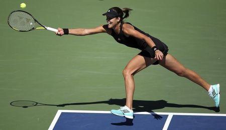 Ana Ivanovic of Serbia hits a return to Karolina Pliskova of the Czech Republic during their match at the 2014 U.S. Open tennis tournament in New York