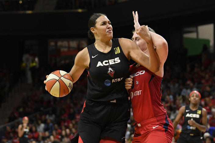 "Center <a class=""link rapid-noclick-resp"" href=""/wnba/players/4840/"" data-ylk=""slk:Liz Cambage"">Liz Cambage</a>, left, led the Las Vegas Aces past the Washington Mystics in game 3 back home at Mandalay Bay Event Center to stay alive. (AP Photo/Nick Wass)"