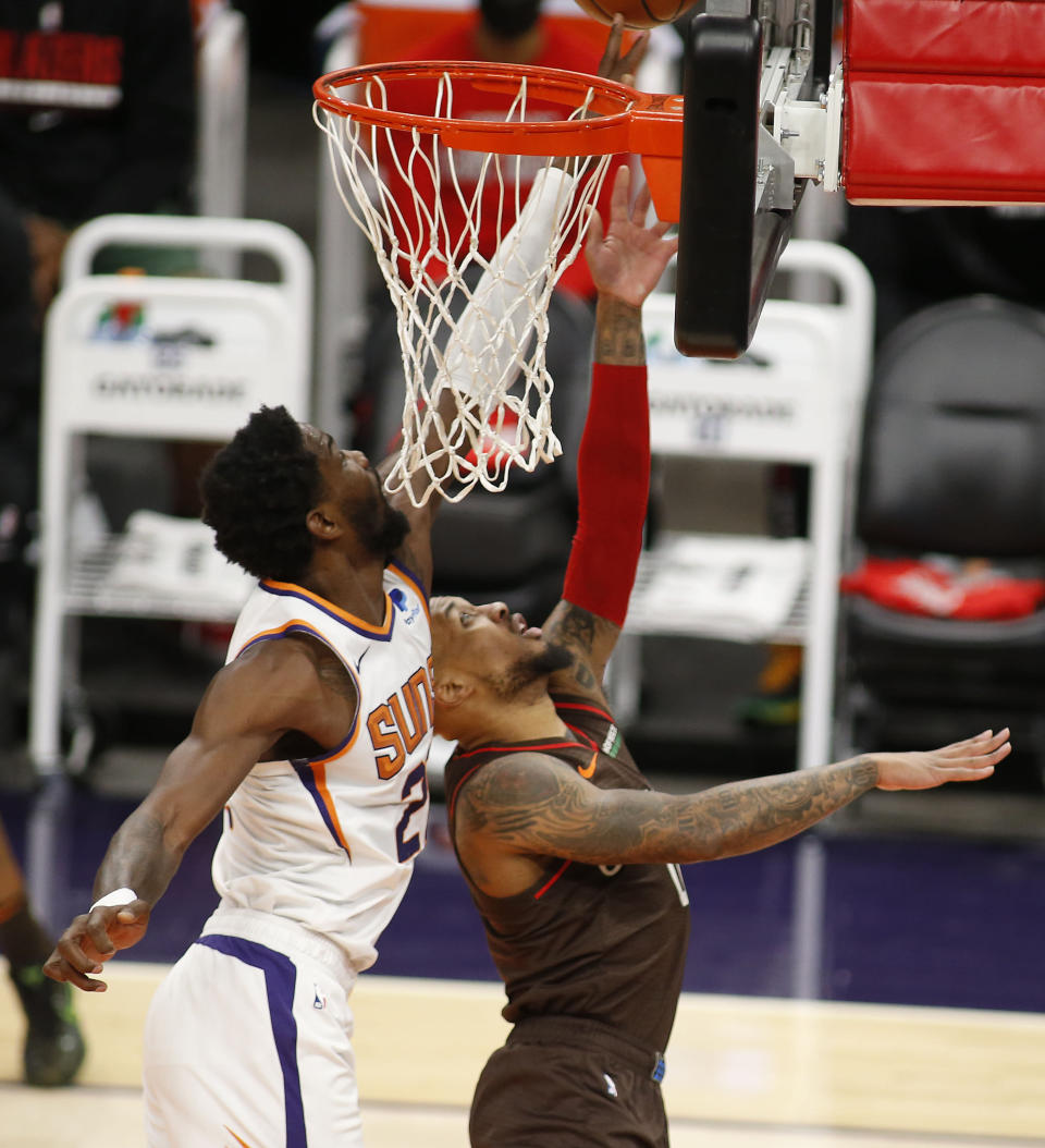 Phoenix Suns' Deandre Ayton blocks the shot of Portland Trail Blazers Damian Lillard during the first half of an NBA basketball game Monday, Feb. 22, 2021, in Phoenix. (AP Photo/Darryl Webb)