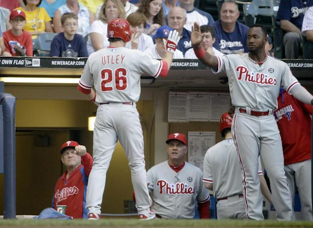 Philadelphia Phillies' Chase Utley is congratulated after hitting a home run during the first inning of a baseball game against the Milwaukee Brewers Wednesday, July 9, 2014, in Milwaukee. (AP Photo/Morry Gash)