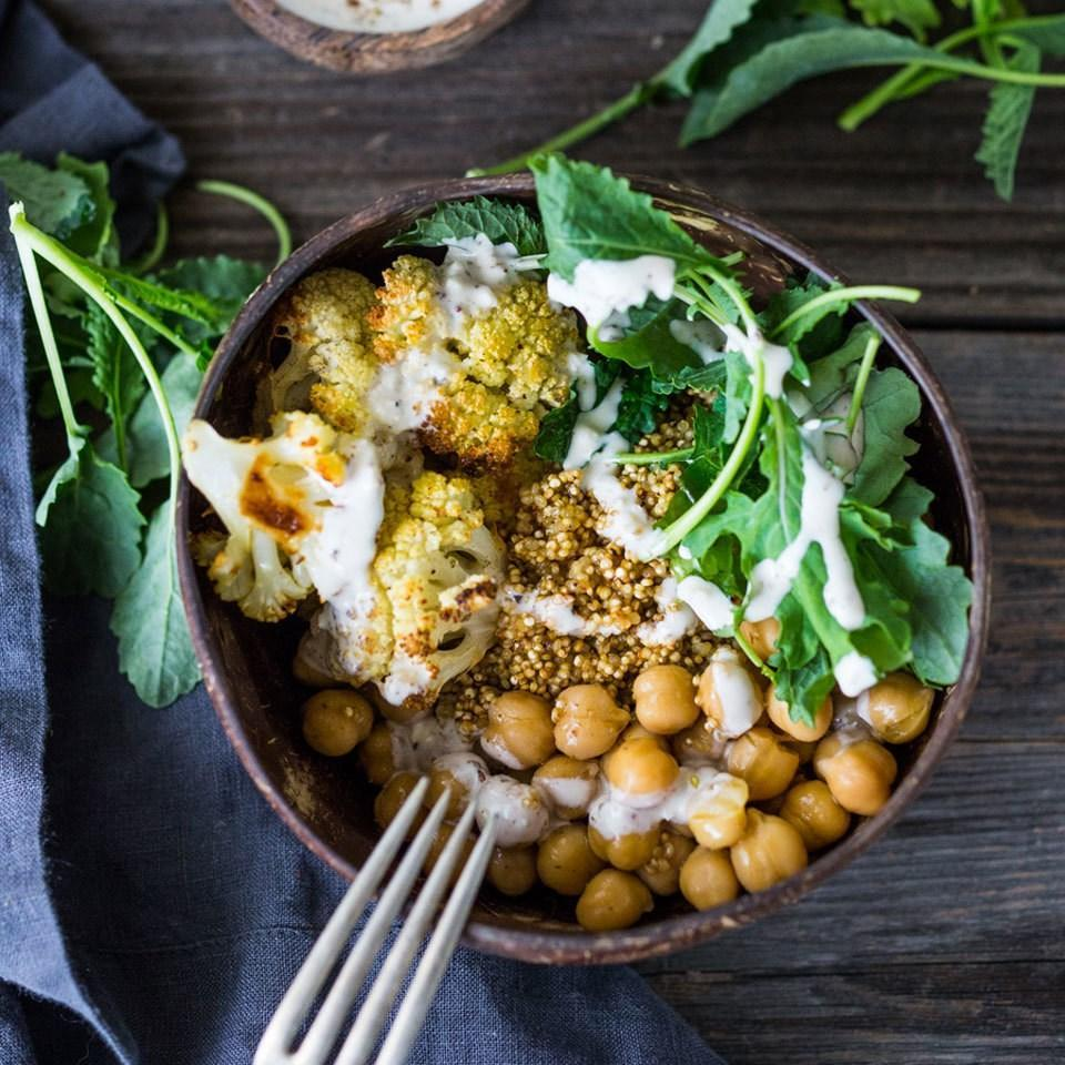 <p>This beautiful grain bowl is packed with healthy ingredients like quinoa, chickpeas, kale and cauliflower--all drizzled with a lemony tahini sauce. The fast one-bowl meal makes a satisfying weeknight dinner or packable work lunch. If you don't have za'atar, you can substitute 1/2 teaspoon each ground cumin and coriander.</p>