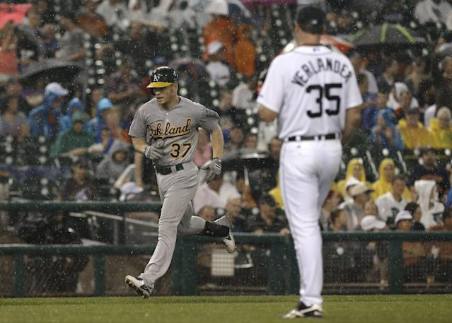Oakland Athletics' Brandon Moss rounds third base after hitting a two-run home run against Detroit Tigers pitcher Justin Verlander (35) in the fifth inning of a baseball game in Detroit, Tuesday, Aug. 27, 2013. (AP Photo/Paul Sancya)
