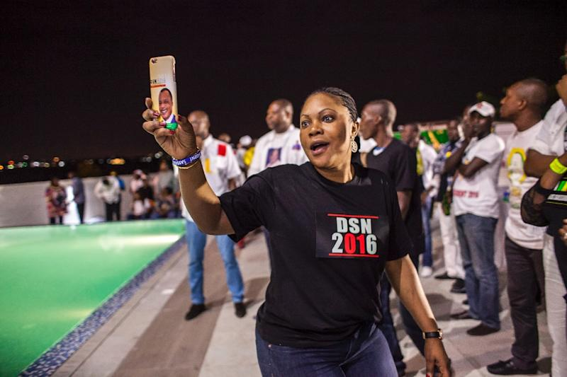 A supporter of newly re-elected Congo President Denis Sassou Nguesso celebrates his victory in Brazzaville on March 24, 2016 (AFP Photo/Eduardo Soteras)