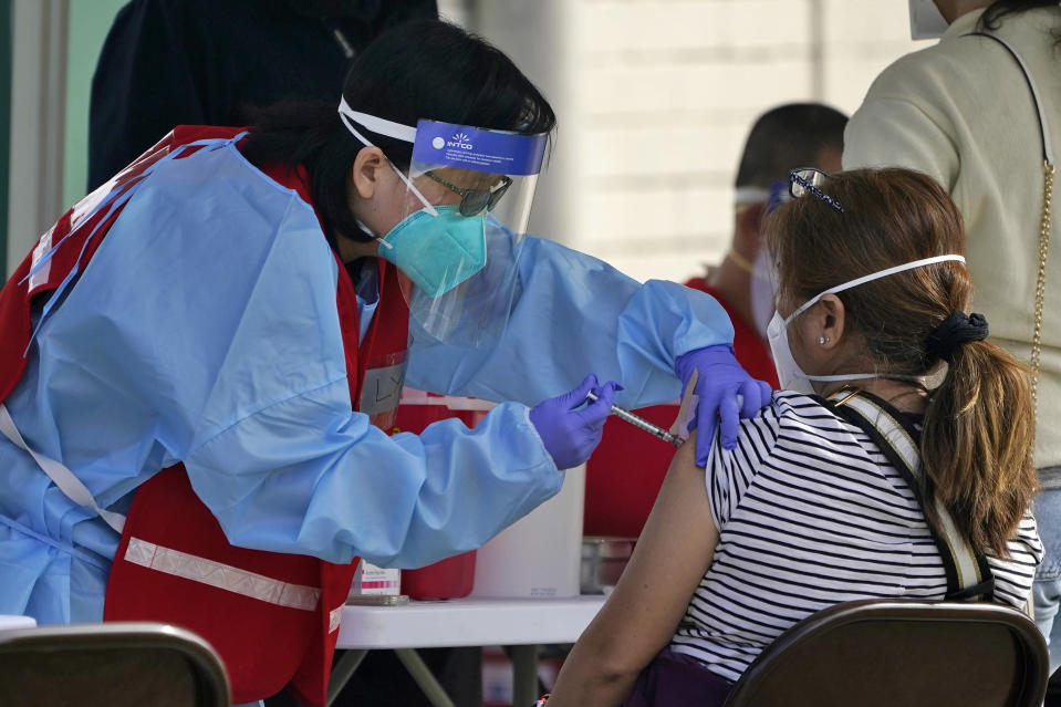 A COVID-19 vaccine is administered at a site for health care workers at Ritchie Valens Recreation Center Wednesday, Jan. 13, 2021, in Pacoima, Calif. (AP Photo/Marcio Jose Sanchez)