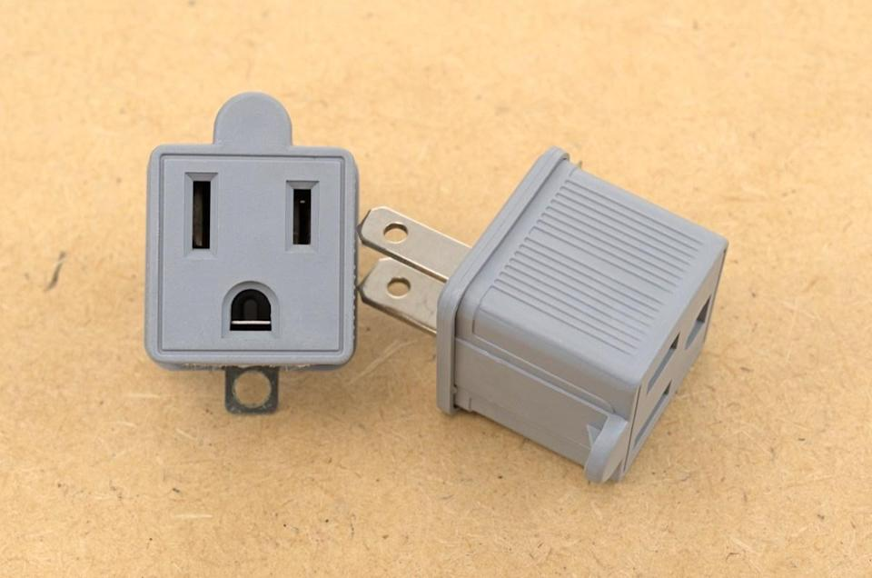 """While it may seem harmless—and cheaper—to use an adapter that allows you to get a three-prong plug to a two-prong wall outlet, the reality is that it's neither. """"You should resist the urge to use these so-called 'cheater plugs,'"""" says Dawson. """"The ground wire is there for safety and simply bypassing it creates a potentially serious hazard."""" Instead, Dawson recommends having a licensed electrician upgrade your outlets to reduce your risk of an electrical fire."""