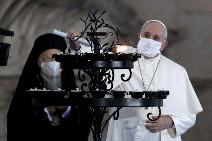 <p>The Pope lights a candle for peace with other religious leaders</p> (Copyright 2020 The Associated Press. All rights reserved.)