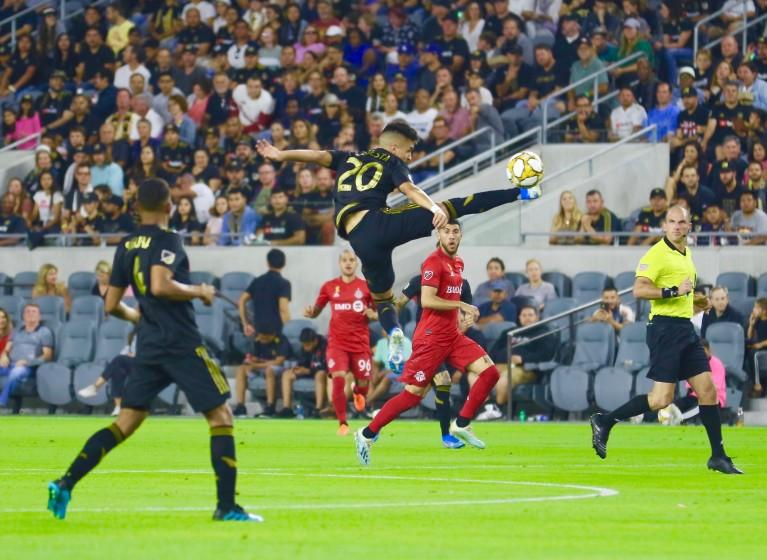 LAFC midfielder Eduardo Atuesta controls the ball in mid-air.