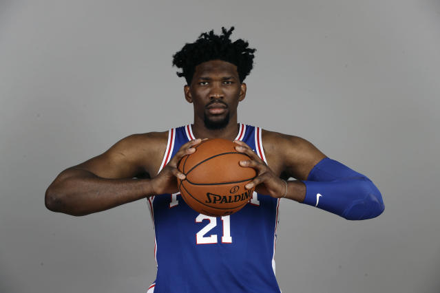 "<a class=""link rapid-noclick-resp"" href=""/nba/players/5294/"" data-ylk=""slk:Joel Embiid"">Joel Embiid</a> can still squeeze a basketball from the sidelines. (AP)"