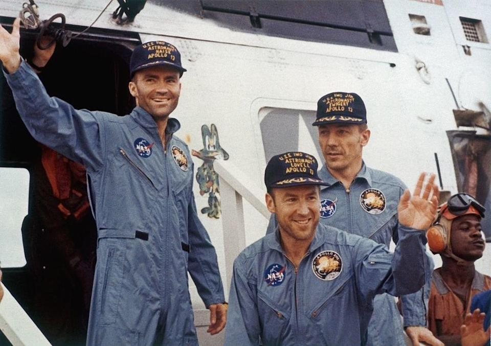 Fred Haise, Jack Swigert, and Jim Lovell wearing NASA uniforms in real life