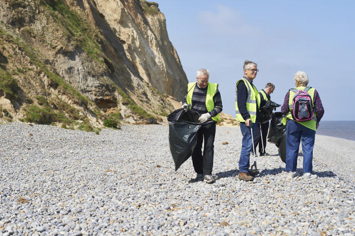 Thoughtful volunteers clearing a UK beach (Getty Images)