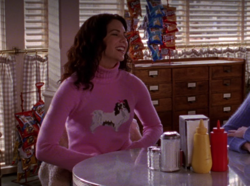 You would pretty much have to be as beautiful as Lauren Graham to appear in public wearing a pink knitted turtleneck emblazoned with the image of a small, annoying dog (although it's surprisingly easy to imagine some vintage-clothing influencer layering it over a lace petticoat today.)