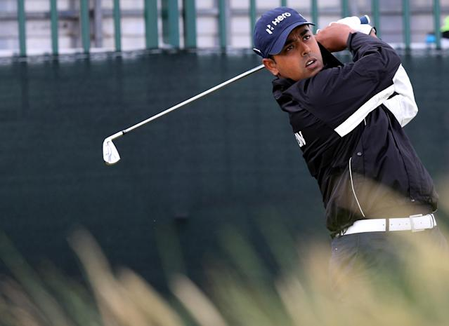 India's Anirban Lahiri tees off from the 13th during a practice round at Royal Liverpool Golf Club prior to the start of the British Open Golf Championship, in Hoylake, England, Monday, July 14, 2014. The 2014 British Open Championship starts on Thursday, July 17. (AP Photo/Scott Heppell)