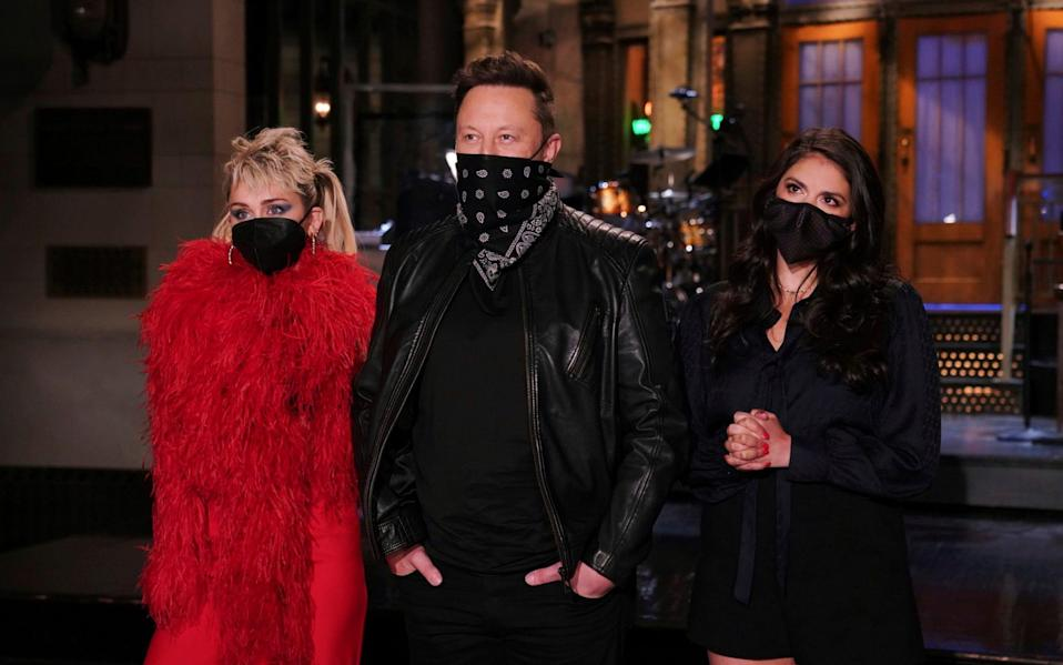 Tesla founder Elon Musk appeared alongside Miley Cyrus and Cecily Strong on Saturday Night Live - Rosalind O'Connor/NBC