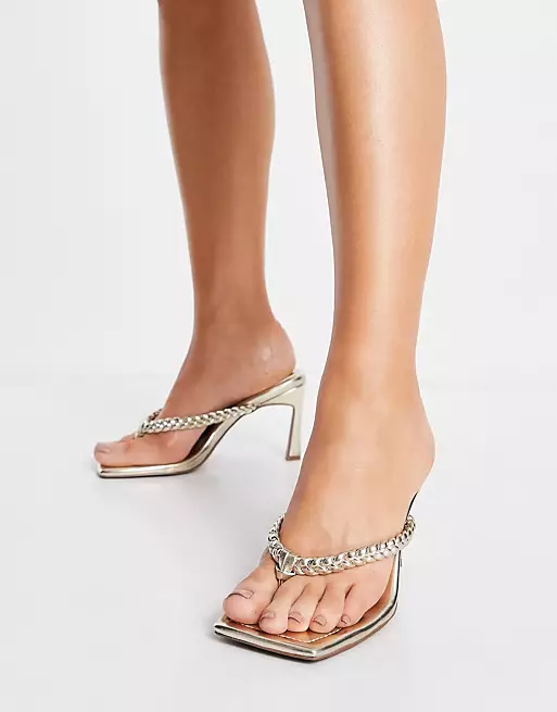 """<br><br><strong>ASOS DESIGN</strong> Haven Braided Toe Thong Heeled Sandals In Gold, $, available at <a href=""""https://go.skimresources.com/?id=30283X879131&url=https%3A%2F%2Fwww.asos.com%2Fus%2Fasos-design%2Fasos-design-haven-braided-toe-thong-heeled-sandals-in-gold%2Fprd%2F22900906%3Fcolourwayid%3D60435070"""" rel=""""nofollow noopener"""" target=""""_blank"""" data-ylk=""""slk:ASOS"""" class=""""link rapid-noclick-resp"""">ASOS</a>"""
