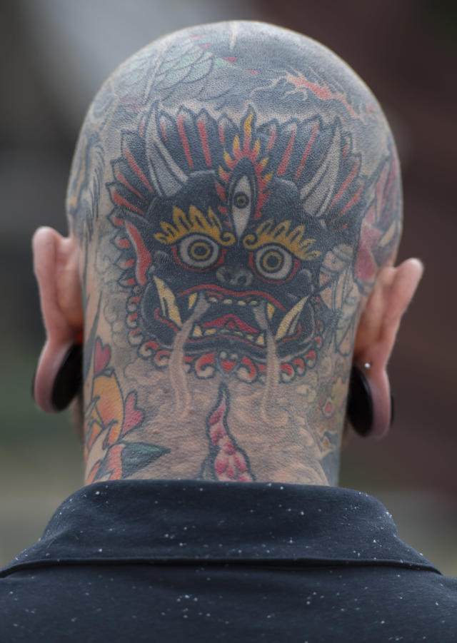 <p>A man's tattooed head at the London Tattoo convention at Tobacco Dock on Sept. 23, 2017 in London, England. (Photo: James D. Morgan/Getty Images) </p>