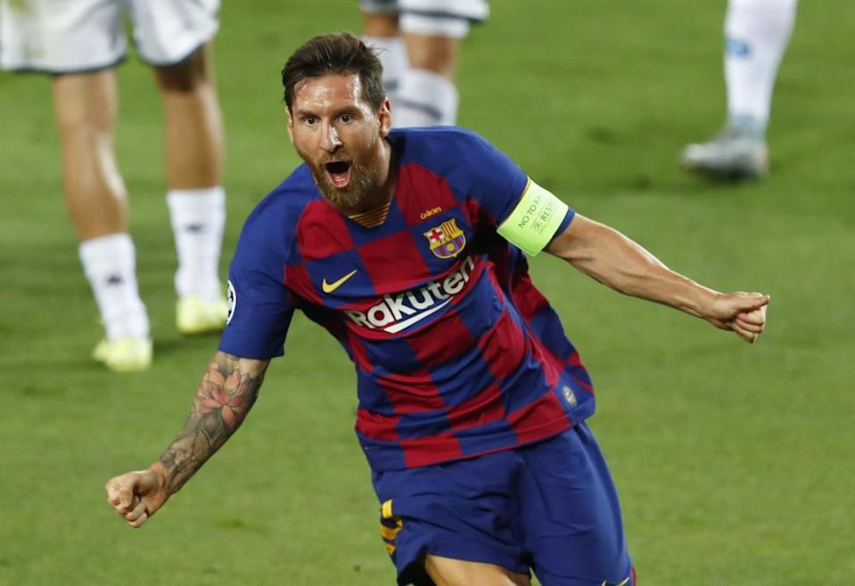 Lionel Messi celebrates after his spectacular solo goal against Napoli.