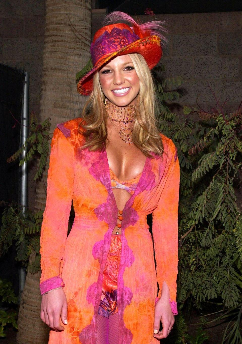 <p>This is iconic and not just because of the hat. It's Britney at the 2000 Billboard Music Awards, and never has anyone ever dressed better for the red carpet.</p>