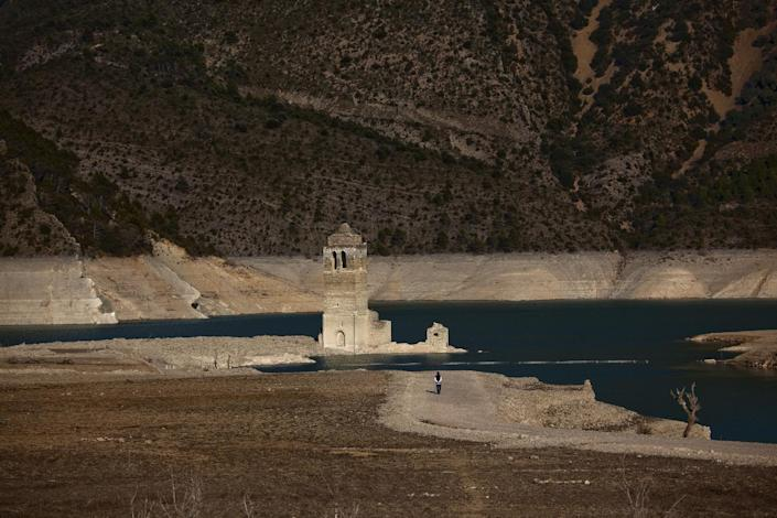A church and remains of an ancient village which are usually covered by water are seen inside the reservoir of Mediano, in Huesca, Spain, Tuesday March 13, 2012. One reservoir built in the 1950s, submerging a village called Mediano and its 16th century church, is so low on water that the ruins of buildings which are usually under water are now uncovered. Spain is suffering the driest winter in more than 70 years, adding yet another woe for an economically distressed country that can scarcely afford it. Thousands of jobs and many millions of euros could be in jeopardy. (AP Photo/Emilio Morenatti)